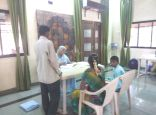 Dr. Shah treating patients at Pen